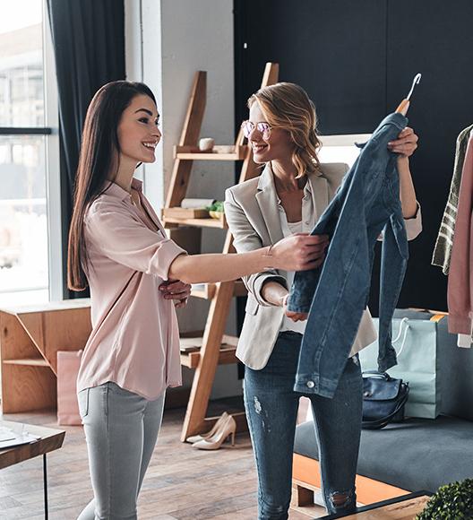 Two female entrepreneurs selecting garments for their fashion dropshipping niche