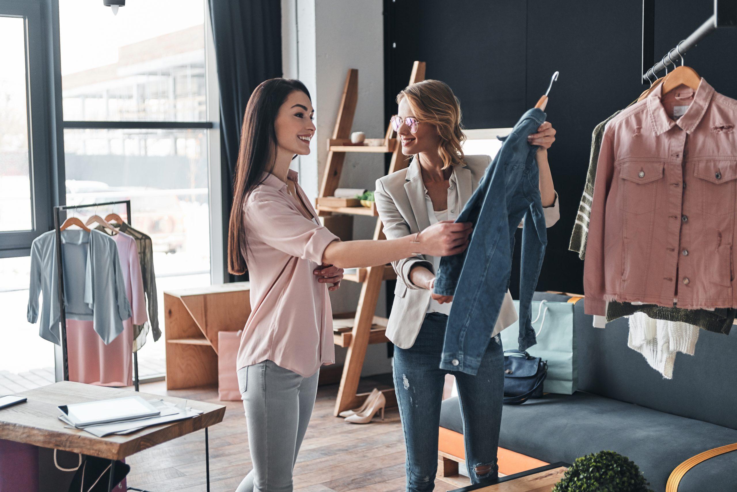 "Two female entrepreneurs selecting garments for their fashion dropshipping niche"""