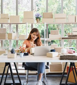 Smiling young woman starting a dropshipping business