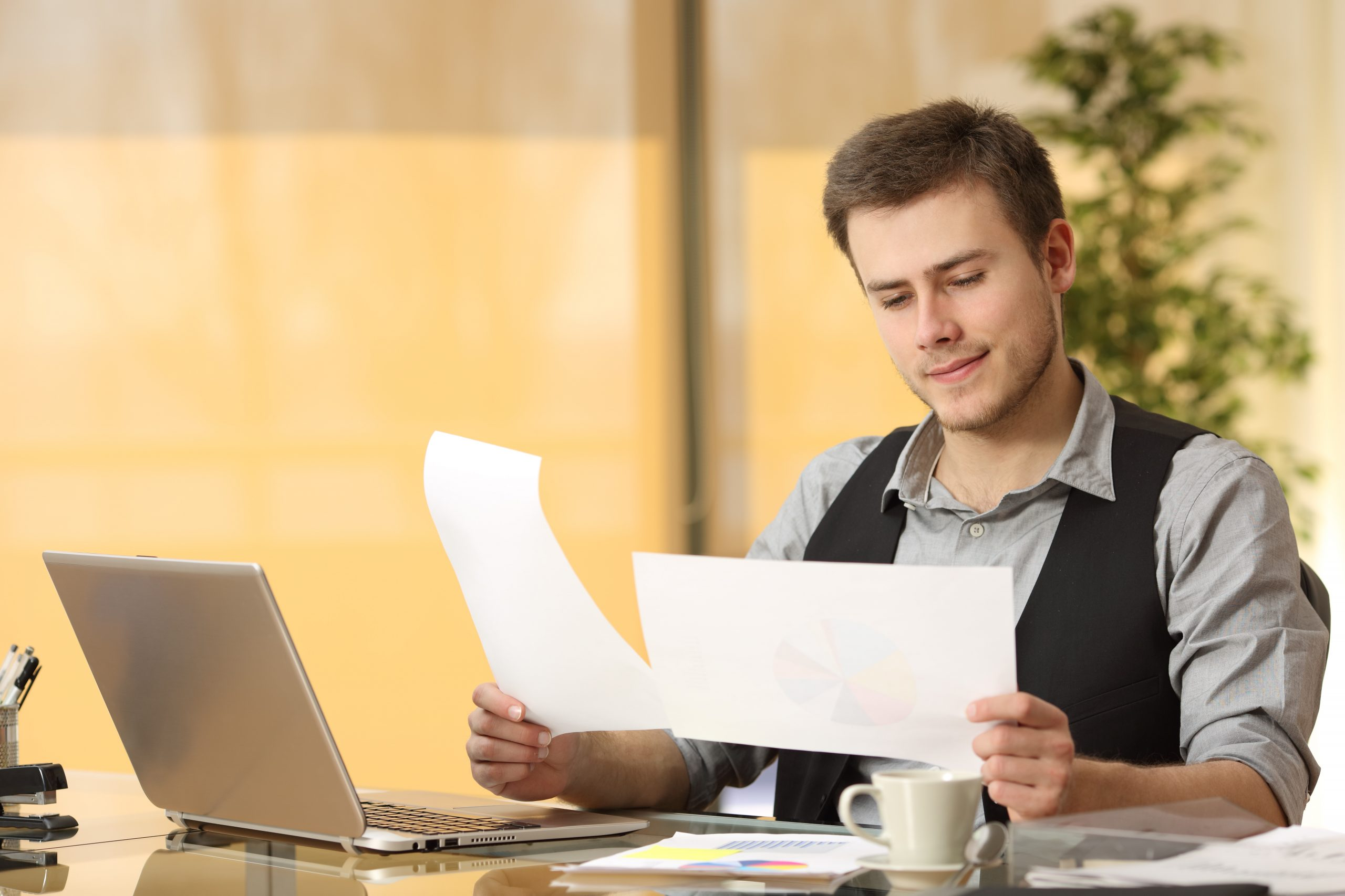 Businessman looking at research documents and assessing different dropship niches