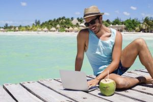 digital nomad running his dropshipping store from an island location