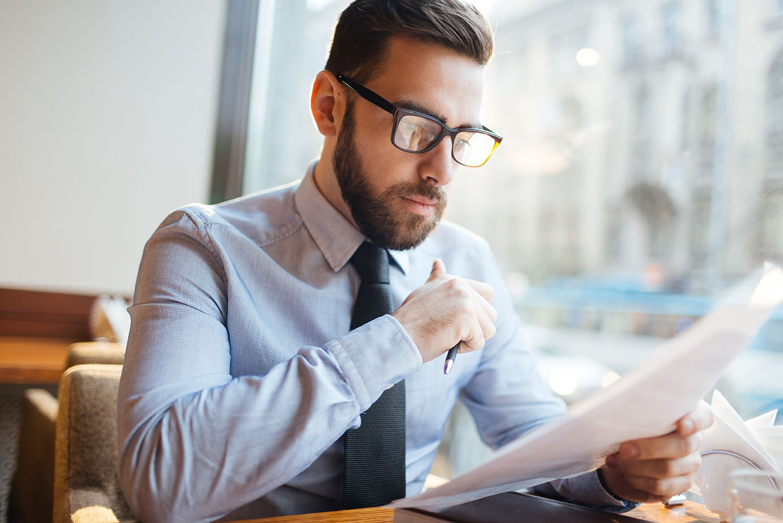 businessman reading important documents
